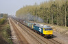47847 passes Brickyard Lane, Melton, at 11:28 on a hazy Friday 10th April 2015, with the 4D94 10:23 Doncaster Down Decoy - Hull Coal Terminal empty Gypsum containers.