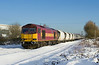 This working was a complete surprise, and stumbled upon by accident - you don't get much luckier than this. Due to the extreme weather conditions, a set of Tarmac hoppers had become stranded in Hull Dairycoates with frozen discharge equipment. On Thursday 9th December 2010, 60019 was dispatched to complete the job of discharging the train and working the empties back to Rylstone. The train is photographed passing Lowfield Lane, Melton, at 14:08. It had been almost two years since a 60 had last worked into Hull Dairycoates!