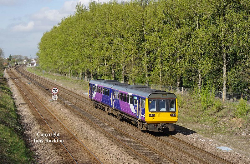 142019 passes Brickyard lane, Melton, forming the 2R05 1019 York - Hull on Thursday 6th April 2017.