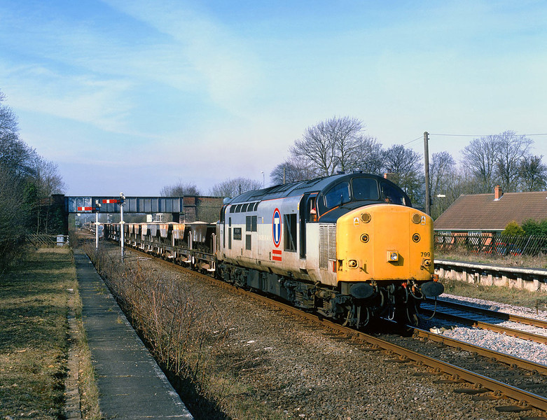On Sunday 19th March 2000, 37799 heads East 'wrong line' through Gilberdyke with a very long rake of Dogfish ballast hoppers, forming the 8T56 Doncaster - Broomfleet engineers trip.