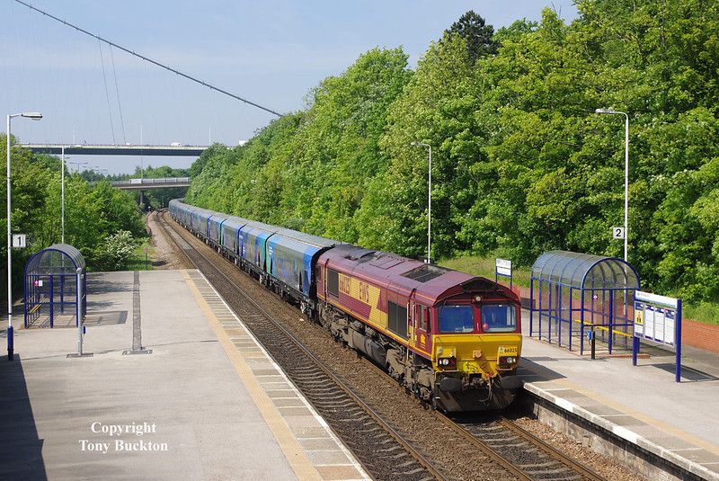 66025 passes Hessle at 11:06 on Monday 19th May 2014 with the 4D73 10:16 Milford West Sidings - Hull Biomass Lp empty hoppers. The rather interesting livery applied to these wagons, and the reduced weathering due to their cargo is a real bonus on these colourful workings. However it has not gone without notice that the Graffiti Vandals (they're not artists) have begun their attacks on some wagons!