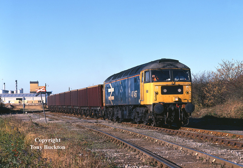 Scruffy Large-logo BR Blue liveried 47467 passes Hedon Road Sidings, Hull King George Dock, with the 6Z83 23:50 Rugby - Hull Coal terminal.<br /> The loaded return was destined for the cement works at Rugby, and was a regular approximately fortnightly working for around a year between 1998 and 1999, which usually turned out decent traction until the sheds took over for the last few months.