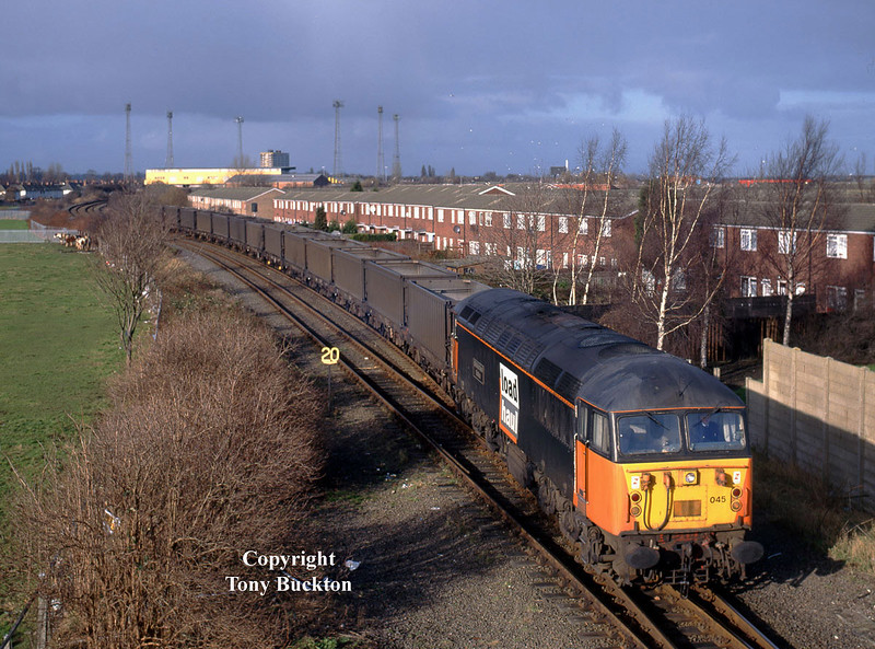 56045 departs from Hessle Rd Jnc, Hull, at 12:55 on Saturday 25th January 1998 with its train of Russell's Coal Containers forming the 6Z80 Hull - Swansea Burrows.