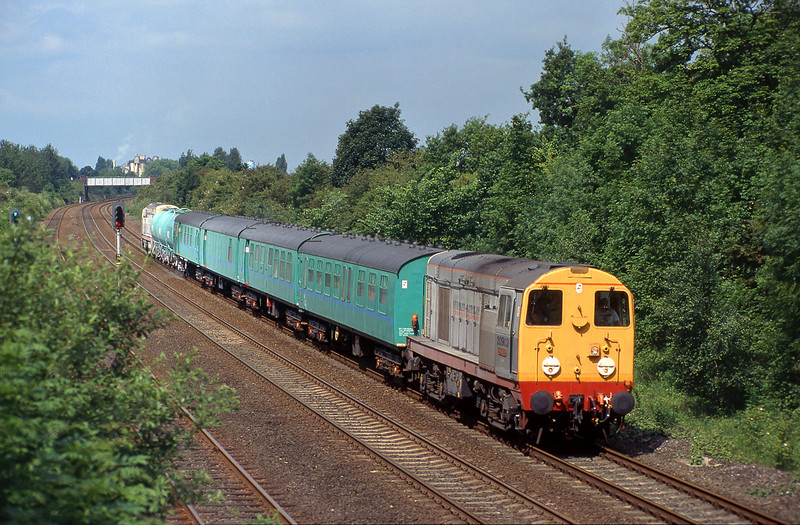 On Tuesday June 20th 1995, 20903 and 20905 head for Hull Paragon with the annual vist of the weedkiller train, pictured passing Ferriby Wood at 11:02.