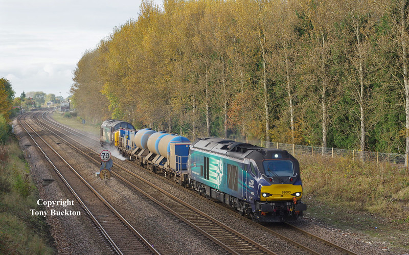 68003 leads the 11:06 Stocksbridge works - York Thrall Europa Sandite on Saturday 29th 0ctober 2016 as the working passes Brickyard Lane, Melton en-route to Hull. 37716 brings up the rear.