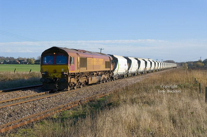 In a filthy condition, 66187 approaches Welton at 11:57 on Wed 20th November 2013, with the 6D72 11:32 Hull Dairycoates - Rylstone Tarmac empties.