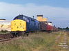 37803 stands in Hedon Road Sidings, Hull King George Dock, at 07:50 on Monday 22nd June 1998 with the 6D89 from Immingham consisting of various covered steel carriers and two bogie tanks - the tanks being destined for South Wales. <br /> From here, the loco would continue to Saltend to pick up 6V14 before working to Baglan Bay.