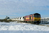 Due to the extreme weather conditions, a set of Tarmac hoppers had become stranded in Hull Dairycoates with frozen discharge equipment. On Thursday 9th December 2010, 60019 was dispatched to complete the job of discharging the train and working the empties back to Rylstone.