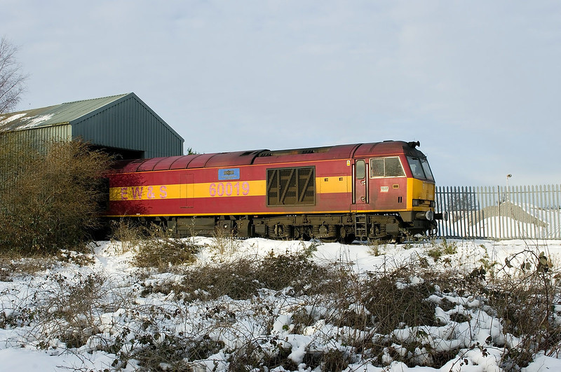 60019 ventures outside the unloading bunker at Hull Dairycoates. Due to the extreme weather conditions, a set of Tarmac hoppers had become stranded in Hull Dairycoates with frozen discharge equipment. On Thursday 9th December 2010, 60019 was dispatched to complete the job of discharging the train and working the empties back to Rylstone.