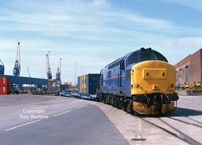 Thursday 29th April 1999 saw 37248 work the 6D51 08:47 Enterprise service from Doncaster to Hull, and is seen in this view shunting lightly loaded container flats on No 10 Quay of Hull King George Dock.