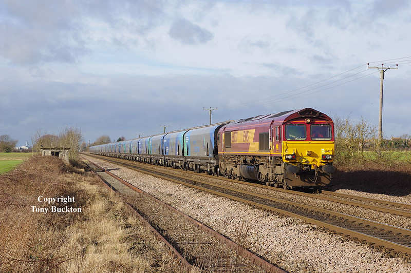 66037 approaches Lowfield Lane, Melton, at 11:37 on Sunday 7th February 2016 with the 10:29 Milford West Sidings - Hull Biomass LP empty hoppers.
