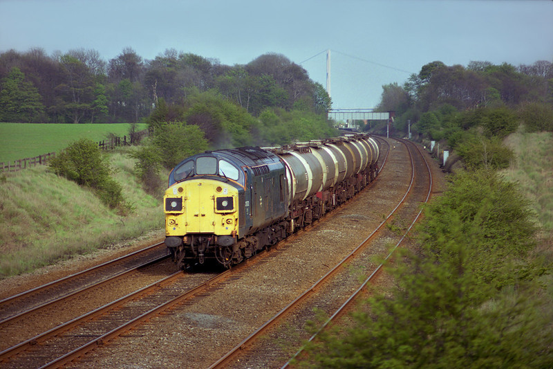37072 heads the afternoon Saltend - Tinsley acetic acid tanks through Ferriby Cutting on the 2nd of May 1989.