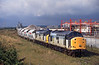 On Monday 1st October 1997, 37708 and 37892 were trusted with the 6D03 / 6D04 Tilcon hoppers from Rylstone to Hull Dairycoates and return - photographed under a threatening sky as they draw away from the terminal before running round to depart back to Rylstone. At this time class 60's were the normal traction, however,despite being unpopular with the customer, on an occasional basis class 37's were deliberately rostered for short periods to keep driver traction knowledge in order, much to the delight of the local enthusiasts.