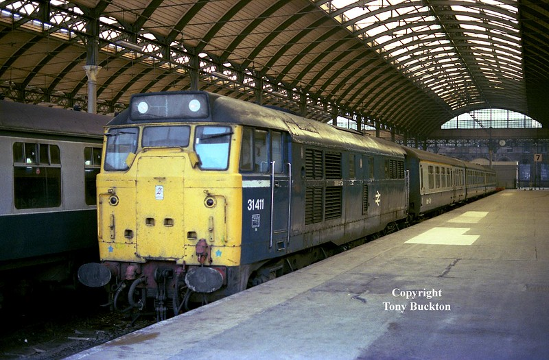 "31411 awaits departure from Hull Paragon at 10:40 on Saturday 9th June 1984 with a short set of Mk 2 a's forming the 1M31 12:08 Hull - Manchester Piccadilly - this working was also photographed by John Chalcraft on the Hope Valley route on the same day.<br /> <a href=""http://railphotoprints.uk/p961810269/h38490fde#h38490fde"">http://railphotoprints.uk/p961810269/h38490fde#h38490fde</a>"