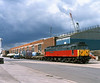 47640 'University of Strathclyde' stands on No10 Quay, Hull King George Dock under a threatening sky at 14:38 on Wednesday 21st July 1999, with a single container from the 6D51 Enterprise service from Doncaster.