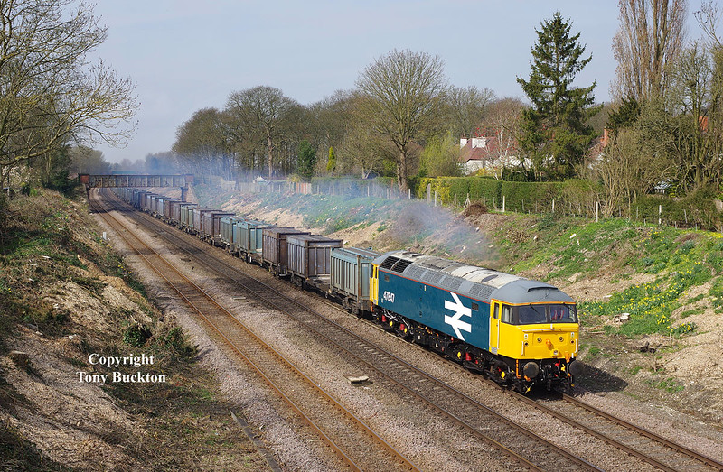 47847 looking tremendous at the head of the 4D94 10:23 Doncaster Down Decoy - Hull coal terminal empty gypsum containers, as it passes through Ferriby Cutting at 11:28 on Wednesday 8th April 2015.<br /> The light could have been stronger, as variable thin high cloud was constantly dipping and brightening the scene - however, as I left home I thought there was little chance of a sunny shot at all, so shouldn't complain.