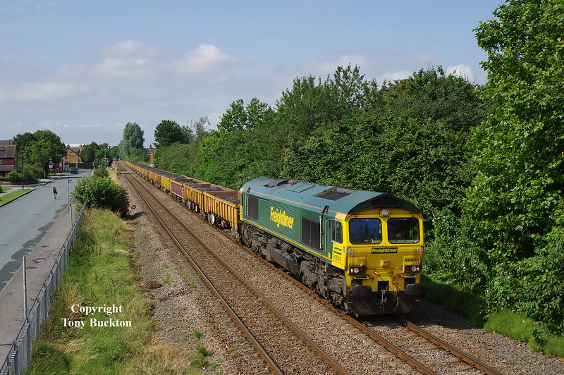 Engineering works at Whitley Bridge on Sunday 20th July 2014 saw a number of workings run to Hull for a reversal via Anlaby Curve and Hessle Rd Jnc, before returning to Doncaster.<br /> 66604 is seen running alongside Selby Street, Hull, at 10:31 with the <br /> 6Y44 09:00 Whitley Bridge - Doncaster Belmont Dwn Yd.
