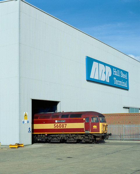 56087 'ABP Port of Hull' is seen poking from the entrance to Hull Steel Terminal at 13:00 on the 1st October 2001. The locomotive had worked to Hull on the daily Enterprise service from Doncaster, which frequently conveyed various covered steel carriers for loading at the Terminal.