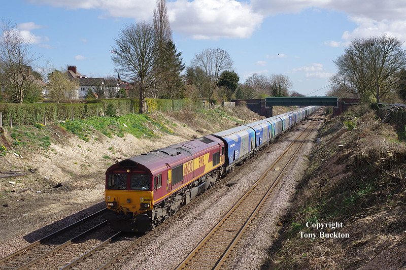 66030 passes through the cutting to the West of Ferriby Station with the 08:38 Hull Biomass L.P. - Drax, at 11:16 on Friday 27th March 2015.<br /> This location has just been extensively opened up by the felling of various large trees and ground based vegetation - the last time I took a photo here was in the mid eighties during a school holiday cycle ride!