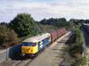 56078 'Doncaster Enterprise' passes the ABP boundary at Southcoates Lane as it departs Hull King George Dock with the 6D54 Enterprise service to Doncaster on the afternoon of 15th October 2003. The locomotive had recently been repainted to mark the end of the class in regular use - the livery being the classic British Rail Large Logo blue of the 1980's - In my opinion the best livery to have adorned any class!