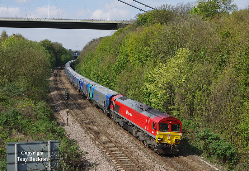 Second Time Lucky! 66118 passes beneath the Humber Bridge on the approach to Hessle at 11:26 on Wednesday 23rd April 2014, with the 6D73 10:25 Milford West Yard - Hull Biomass LP empty hoppers.