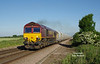 66187 passes Lowfield Lane, Melton, at 07:24 on Tuesday 30th June 2015, with the 04:16 Rystone - Hull Dairycoates Tarmac hoppers.