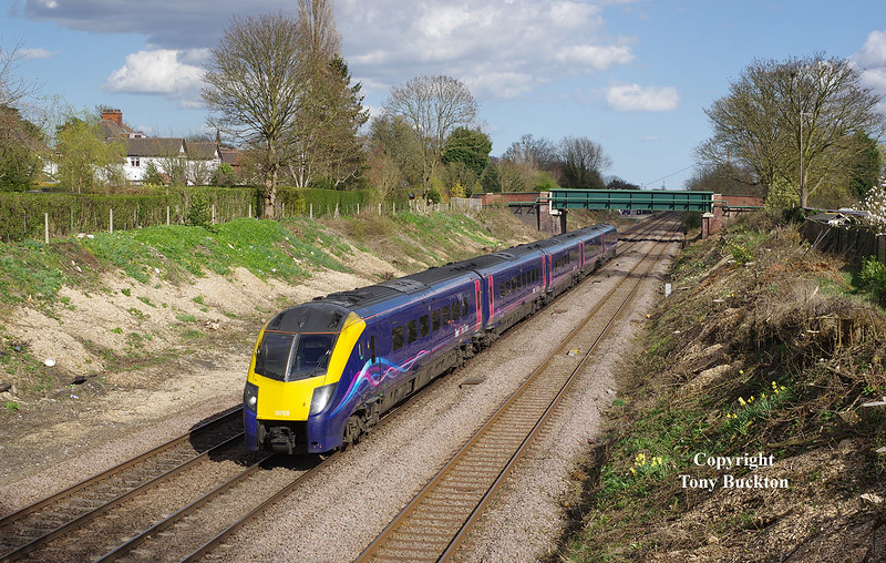 180109 passes through Ferriby Cutting on Sat 11th April 2015, forming the 1A95 15:30 Hull - London Kings Cross .