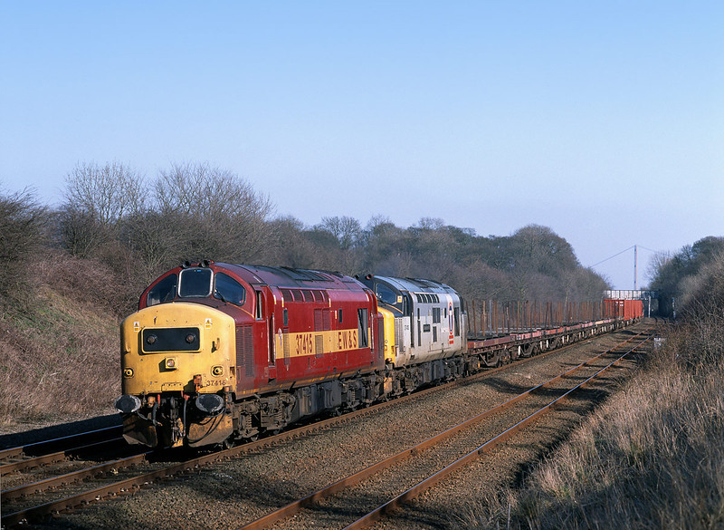 37415 and 37410 storm through Ferriby Cutting with the 6D54 Enterprise Service to Doncaster, at 14:40 on March 14th 2003. The brown coloured containers at the rear of the train had been constructed locally for the MOD, and became a regular feature of the service for a few weeks.