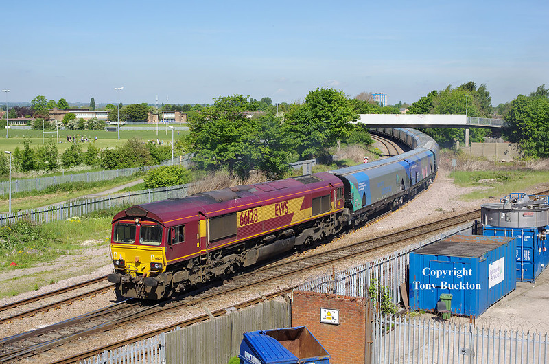 66128 leaves the branch that serves Hull King George Dock at Hessle Road Junction on Saturday 17th May 2014, with the 6H84 08:47 Hull Biomass LP - Drax Power Station loaded hoppers.