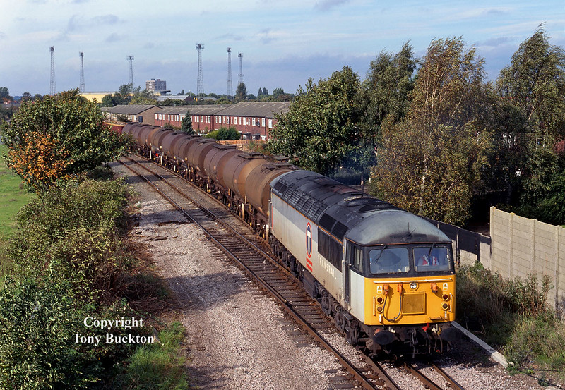 56072 approaches Hessle Road Jnc, Hull, with the late running 6D52 Saltend - Mostyn Dock acetic acid tanks, on the 4th October 2001. The rear portion of the train is formed of Mega Boxes conveying scrap for Liverpool Alexandra Dock, which would be set down at Healey Mills.