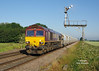 66187 passes Crabley Creek at 07:16 on Friday 3rd July 2015, with the 04:16 Rystone - Hull Dairycoates Tarmac hoppers.