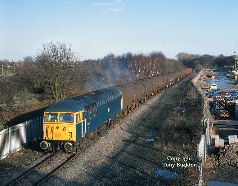 56006 is seen departing Hull King George Dock at Southcoates lane on Monday  11th Feb 2002 with the 6D54 enterprise service to Doncaster.<br /> The building work on the right of the photograph was in connection with an extension to Hull Prison being built over the former rail connected timber yard. This shot has now been lost due to a combination of the shadows cast by the prison wall and the doubling of this section moving the outbound running line closer to it - a signal also obscures the view.