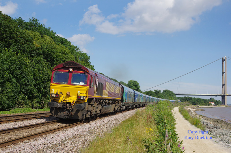 66059 runs along the North bank of the Humber at Hessle Foreshore with the 7H73 14:21 Hull Biomass LP - Drax PS - 15:51 Monday 21st July 2014.