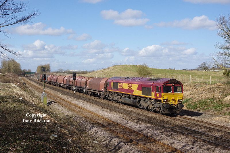 66140 passes Ferriby Cutting at 10:42 on Friday 27th March 2015 with the 08:22 Masborough F.D. - Hedon Road Sidings steel hoods.