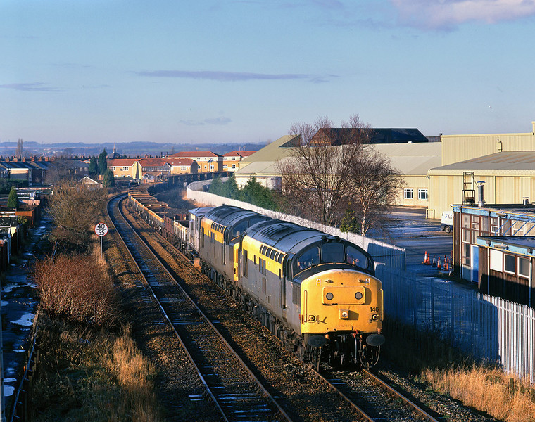 37146 and 37069 pass the works of Ideal Standard, Hull (manufactirers of boilers and bathroom equipment) at 11:45 on Sunday January 10th 1999, with a lengthy engineers trip from Driffield to Doncaster - running as 7T72.