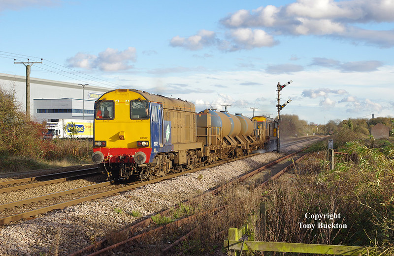 20302 and 20305 pass the site of the former Croxton & Garry sidings at Lowfield Lane, Melton, at 1412 on Saturday 7th November 2015 forming the 3S14 11:02 Stockbridge Works - York Thrall Europa Rail-head Treatment Train.