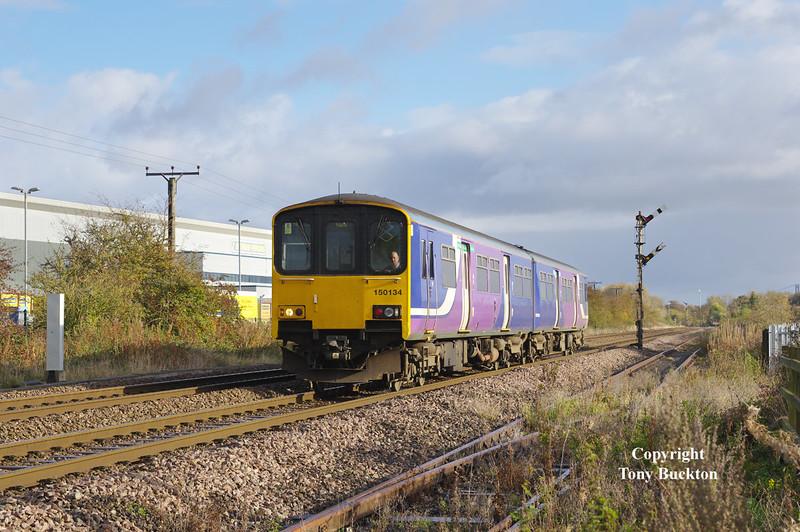 150134 passes the Heron Foods distribution depot at Lowfield Lane, Melton, forming the late running 2R06 12:04 Hull - York at 12:53 on Saturday 5th November 2016.