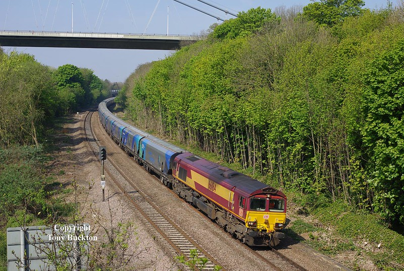 66184 approaches Hessle at 10:06 on Saturday 7th May 2016 with the 09:15 Milford West Sidings - Hull Biomass empty hoppers.