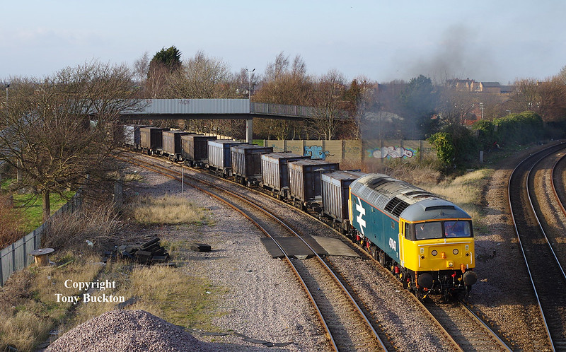 47847 departs from Hessle Road Junction, Hull, with the 6D95 15:00 Hull Coal Terminal - Doncaster Down Decoy gypsum containers at 16:16 on Friday 20th March 2015.
