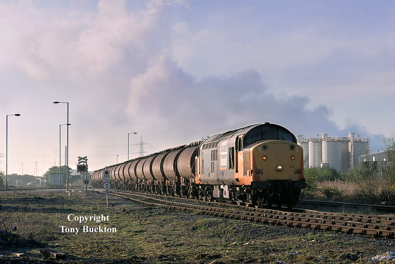 37710 crosses the Eastern Access road onto Hull King George Dock at 07:10 on the morning of April 30th 2001 with the 6V14 Saltend - Baglan Bay acetic acid tanks.