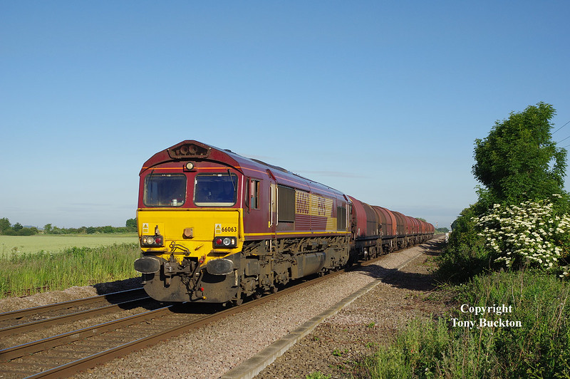 66063 passes Lowfield Lane, Melton, at 07:03 on Tuesday 30th June 2015, with the 05:36 Masborough - Hedon Road Sidings steel hoods