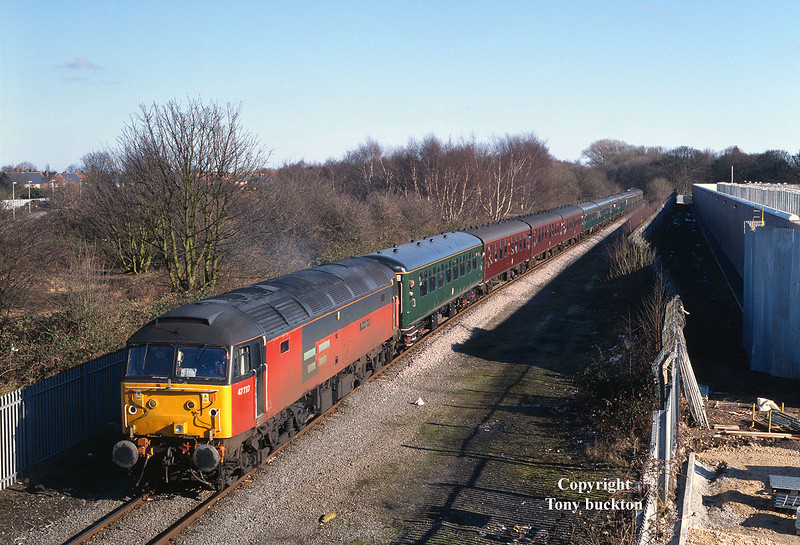 47737 heads the Crown and Scepter railtour from Hull King George Dock at 13:05 on Saturday 15th February 2003 as the ensemble passes Southcoates Lane. <br /> The tour originated from London Kings Cross and included 66083 at the tail end for this section of the tour.<br /> The building works to the right of the shot are for the extension to Hull's Hedon Road prison, and occupies the site of a former rail served timber yard.
