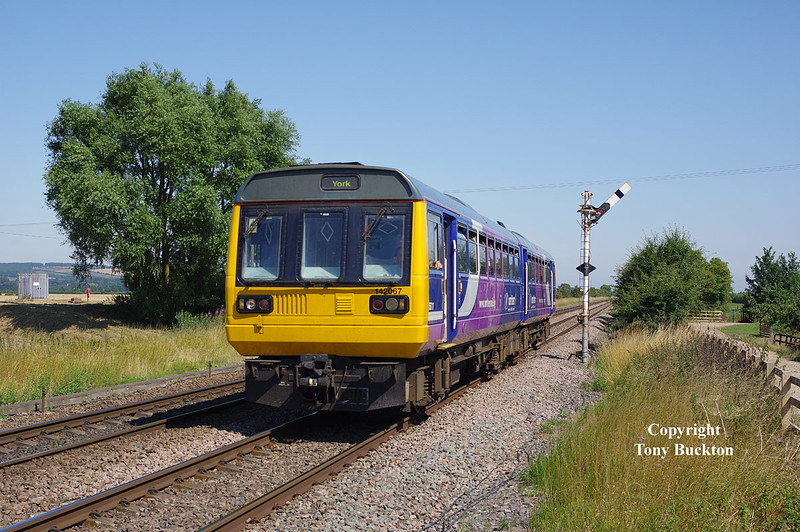 142067 passes Crabley Creek at 15:17 on Wed 23rd July 2014 forming the 2R08 15:03 Hull - York.