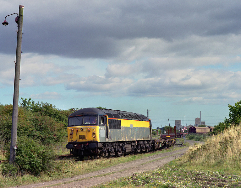 56031 approaches Hedon Rd sidings, Hull King George Dock, with the 6D54 Enterprise service to Doncaster, at 13:45 on Thursday 6th September 2001.