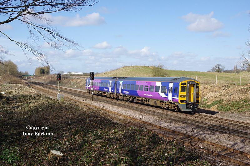 158150 passes through Ferriby Cutting as the 2c20 0952 Doncaster - Hull on Friday 27th March 2015.