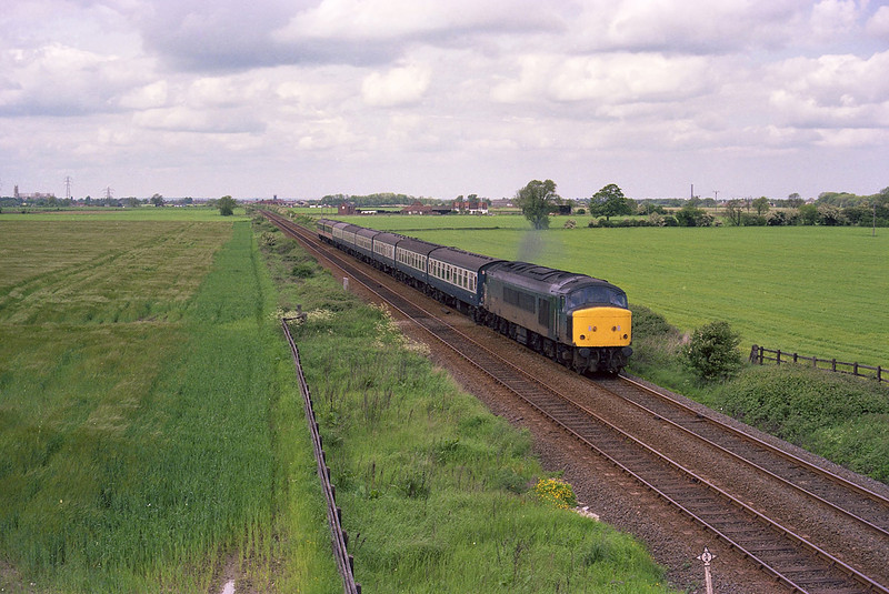 45033 heads South from Beverley as it approaches the then new Southern bypass on Saturday 8th June 1985, with the summer Saturdays Only Scarborough - Leicester.