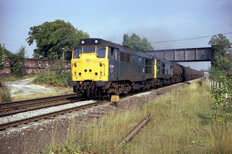 31296 and 31288 storm through Hessle with the 6m63 Saltend - Toton acetic acid tanks at aprox 15:00 on the 28th August 1984. Pairs of class 31's were quite unusual on this working - more typical traction would be in the form of a Tinsley allocated 37 or 47.