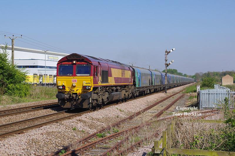 66096 passes Lowfield Lane, Melton. at 15:55 on Monday 9th May 2016 with the 14:21 Hull - Drax Biomass.