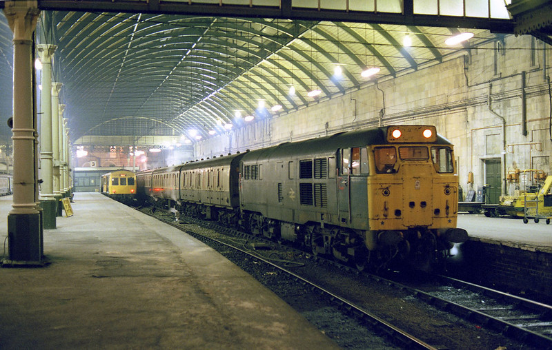 31187 awaits departure from Hull Paragon with the steam heated 19:17 to Leeds on the evening of the 5th February 1985.