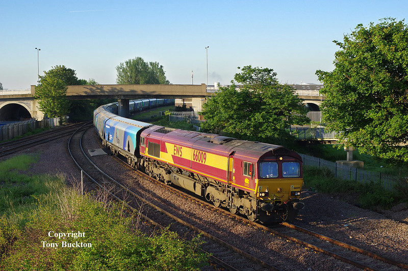The early bird catches the worm - ok not the shot of the year, however, recent vegetation clearance has opened up this shot at Hessle Rd Jnc, Hull,  and 66009 is seen passing at 05:48 on Friday 6th June 2014 with the 02:15 Drax PS - Hull Biomass Lp empty hoppers.<br /> Unfortunately running around 20 mins early resulted in the shadows still being quite prolific - a running on time shot about a fortnight later should provide much better results.<br /> In comparison  to the previous shot at this location - note that the signs have disappeared  from the posts in the medium distance.